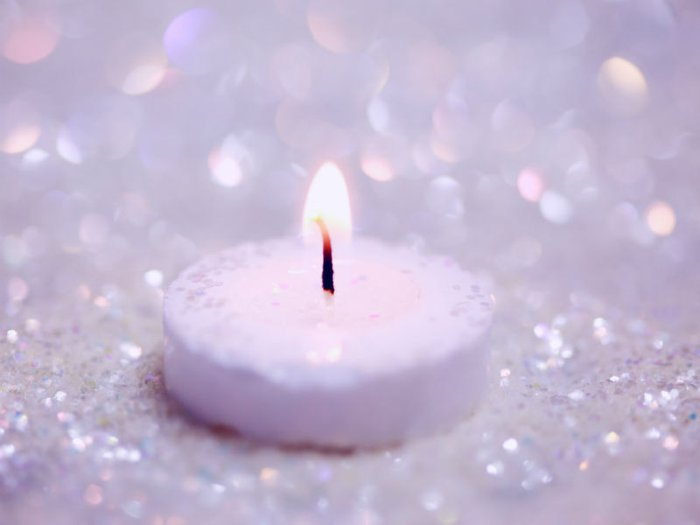 white candle and glitter