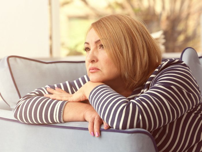 A bereaved woman looking sad and pensive
